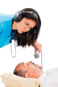 Doctor recording snoring with microphone
