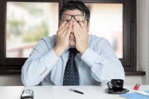 man struggling to stay awake