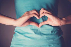 woman heart shape stomach lack of sleep affects gut health